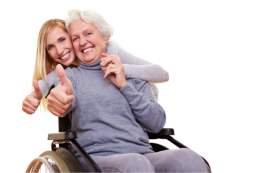 caregiver with elderly patient smiling